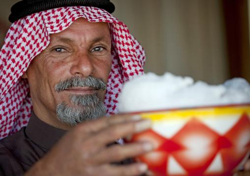 Saudi man drinking fresh camel milk, Riyadh Province, Riyadh, Saudi Arabia
