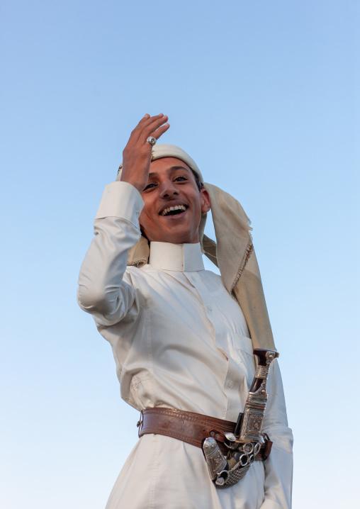 Young saudi man in traditional clothing wearing a jambyia, Al-Sarawat, Fifa Mountains, Saudi Arabia