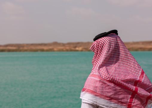 Rear view of a saudi man looking at the red sea, Jizan Region, Farasan island, Saudi Arabia