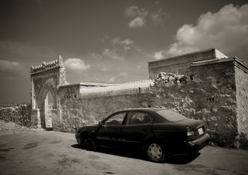 Car parked in front of an old ottoman gate, Red Sea, Farasan, Saudi Arabia
