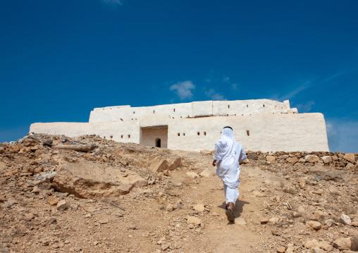 Saudi man in qal at al-atrak the ottoman castle, Jizan Region, Farasan island, Saudi Arabia