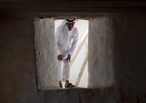 Saudi man entering the Turkish fort, Red Sea, Farasan, Saudi Arabia