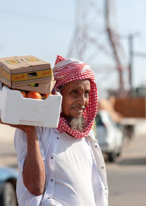 Portrait of a saudi man in a market wearing a kaffiyeh, Jizan Province, Sabya, Saudi Arabia
