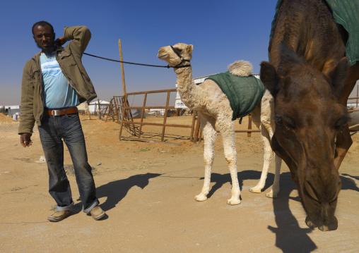 Man in the camel market, Riyadh Province, Riyadh, Saudi Arabia