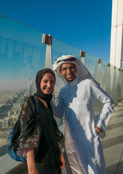 Saudi couple at the top of the kingdom center, Riyadh Province, Riyadh, Saudi Arabia