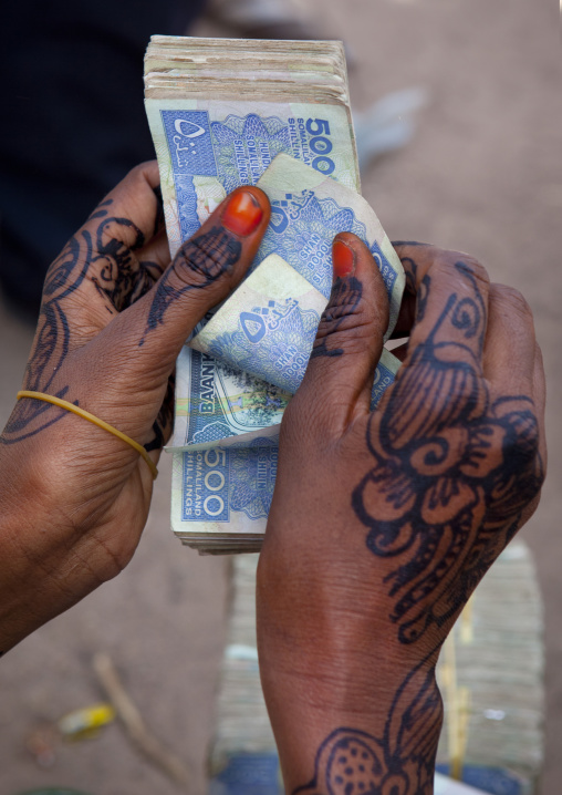 A Woman Is Counting Five Hundred Schillings With Her Painted Hands, Hargeisa, Somaliland