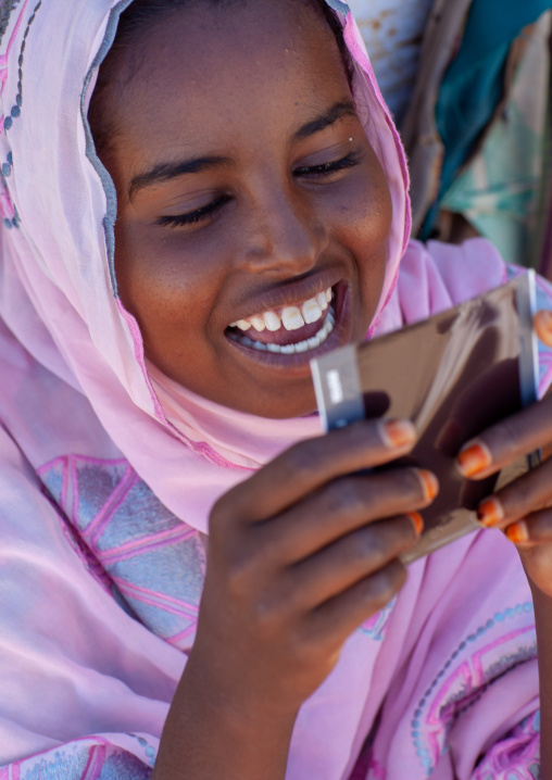 Portrait of a somali young woman dicvovering herself on a polaroid picture, North-Western province, Berbera, Somaliland