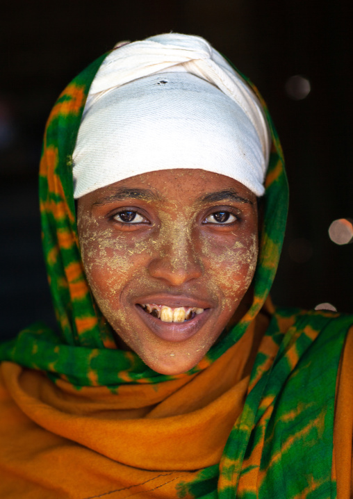Portrait of a smiling somali girl with qasil on her face, North-Western province, Berbera, Somaliland