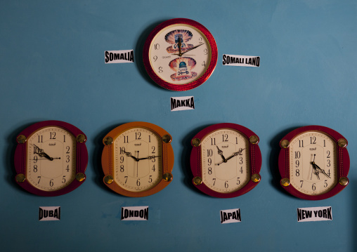 Five Clocks Indicating The Time In Other Capital Cities In The World Hanging On A Blue Wall, Burao, Somaliland