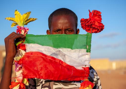 Portrait of a teenage boy with a national flag, Togdheer region, Burao, Somaliland