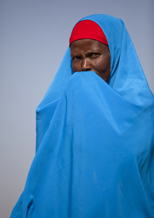 A Woman Wearing A Blue Hijab Is Hiding Her Mouth In Her Hands, Burao, Somaliland
