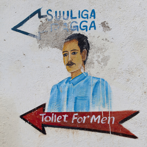A Painted Sign Showing The DIrection Of Toilet For Men In A Restaurant, Berbera, Somaliland