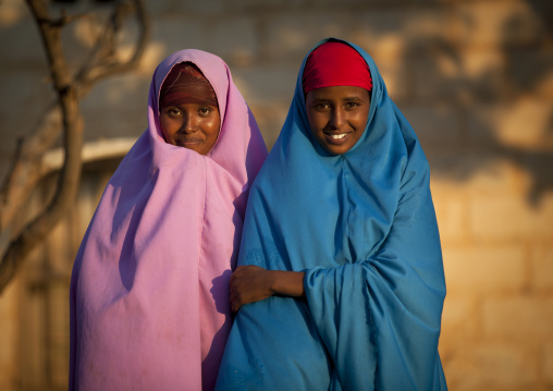 Two Cute Teenage Girls Wearing Colorful Dresses In The Declining Light, Baligubadle, Somaliland