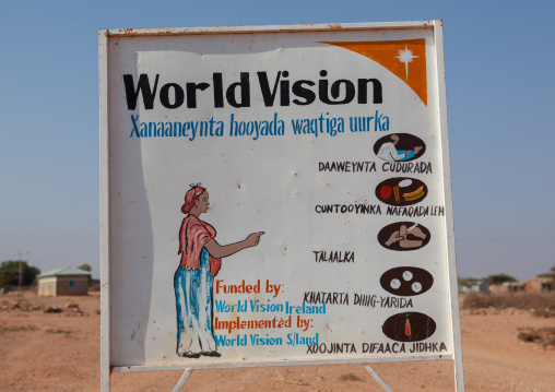 A painted billboard advertisement for world vision ngo about health, Woqooyi Galbeed province, Baligubadle, Somaliland