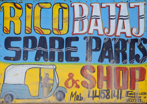 A Painted Bilboard Advertising For A Garage Repairing Cars And Selling Parts, Boorama, Somaliland