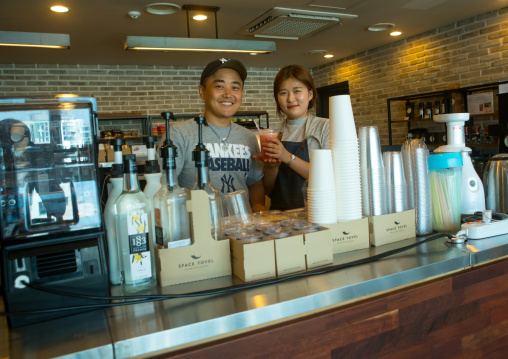 North korean defector joseph park with huaryeong working at yovel cafe in ibk bank, National capital area, Seoul, South korea