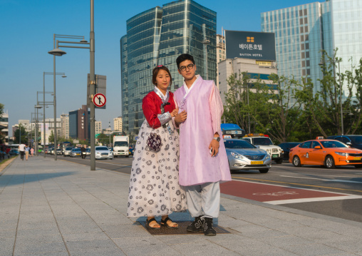 Couple in traditional korean clothing in the street, National capital area, Seoul, South korea