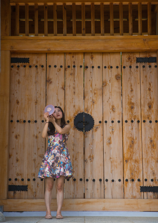 South korean woman called juyeon in front of a temple door, Sudogwon, Paju, South korea