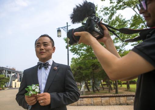 North korean defector joseph park with his south korean fiancee recording a video on the dmz, Sudogwon, Paju, South korea