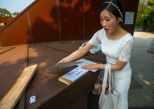 South korean woman called juyeon south korean woman called juyeon looking at herself in a mirror, Sudogwon, Paju, South korea