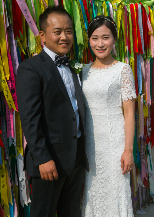 North korean defector joseph park with his south korean fiancee juyeon in front of messages of peace written on ribbons left on dmz, Sudogwon, Paju, South korea