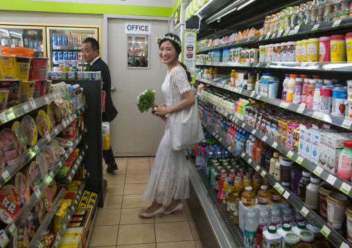 North korean defector joseph park with his south korean fiancee juyeon in a supermarket in imjingak, Sudogwon, Paju, South korea