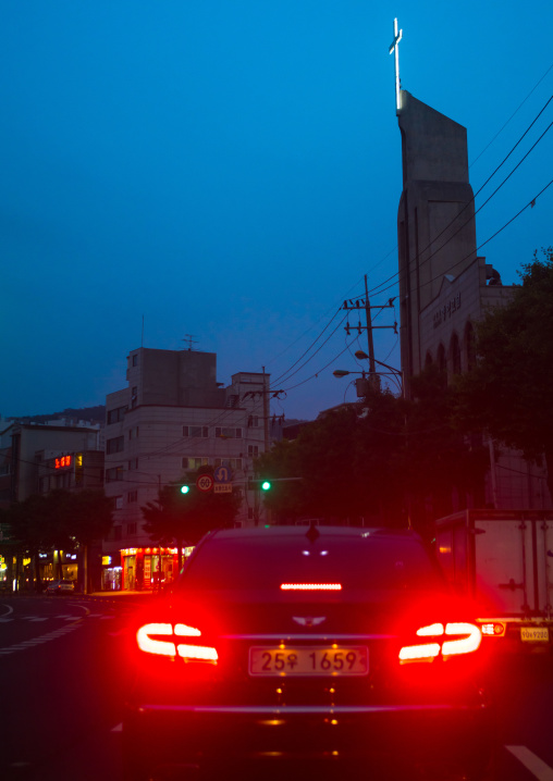 Car passing in front of a church, National capital area, Seoul, South korea