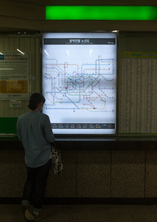 Korean woman looking at subway station map, National capital area, Seoul, South korea