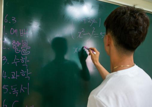North korean teen defector in yeo-mung alternative school during a math course, National capital area, Seoul, South korea
