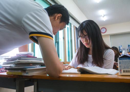 North korean teen defector with her teatcher in yeo-mung alternative school, National capital area, Seoul, South korea
