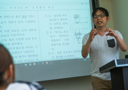 Teatcher in yeo-mung school welcoming north korean teen defectors, National capital area, Seoul, South korea