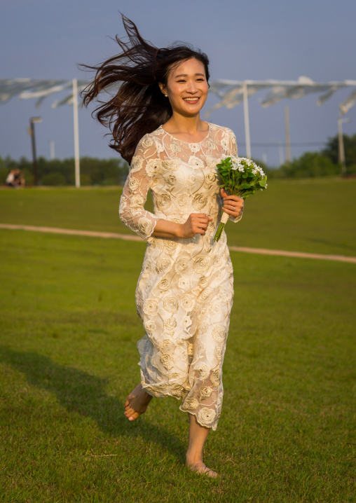 South korean woman called juyeon running in a wedding dress, Sudogwon, Paju, South korea