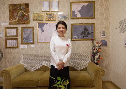 North Korean defector guide mrs moon during the exhibition Pyongyang sallim at architecture biennale showing a north Korean apartment replica, National Capital Area, Seoul, South Korea
