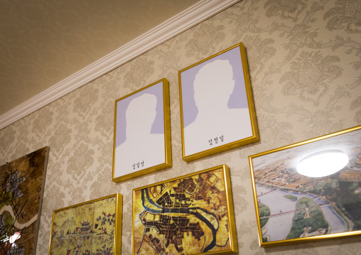 Frames without pictures of the dear leaders during the exhibition Pyongyang sallim at architecture biennale showing a north Korean apartment replica, National Capital Area, Seoul, South Korea