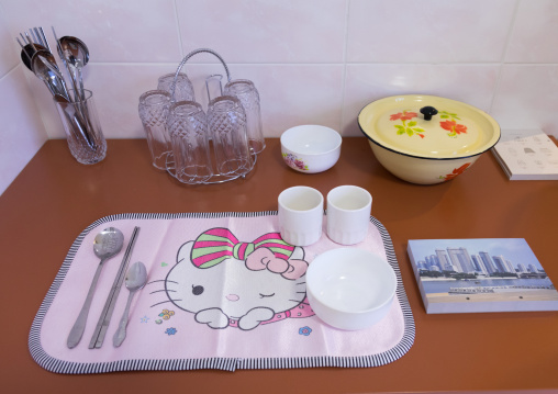Hello Kitty table set during the exhibition Pyongyang sallim at architecture biennale showing a north Korean apartment replica, National Capital Area, Seoul, South Korea