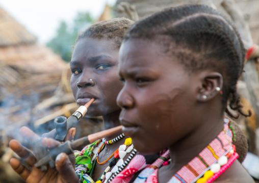 Toposa tribe women smoking pipes, Namorunyang State, Kapoeta, South Sudan
