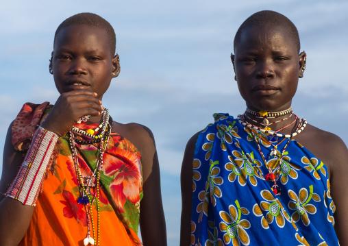 Toposa tribe young women in traditional clothing, Namorunyang State, Kapoeta, South Sudan