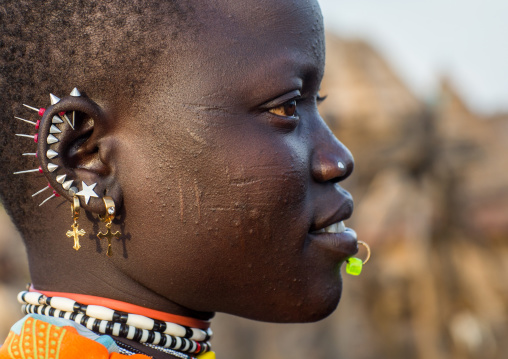 Portrait of a Toposa tribe woman with scarifications on the cheek, Namorunyang State, Kapoeta, South Sudan