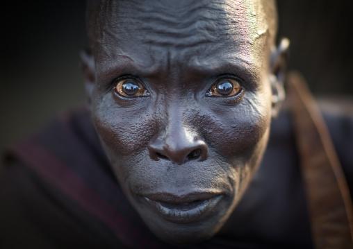 Portrait of a Toposa tribe man with shocked big eyes, Namorunyang State, Kapoeta, South Sudan