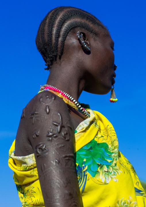 Larim tribe woman with scarifications on her body, Boya Mountains, Imatong, South Sudan