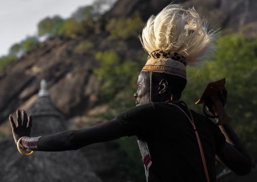 Larim tribe man dancing during a wedding ceremony, Boya Mountains, Imatong, South Sudan