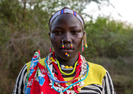 Portrait of a Larim tribe woman with traditional eaerrings and nose earrings, Boya Mountains, Imatong, South Sudan
