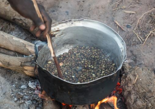 Mundari tribe woman roasting coffee, Central Equatoria, Terekeka, South Sudan