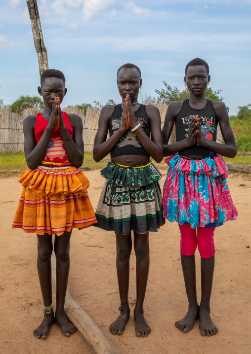 Mundari tribe girls praying, Central Equatoria, Terekeka, South Sudan