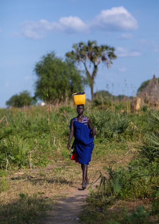 Mundari tribe woman carrying a yellow jerrican on the head, Central Equatoria, Terekeka, South Sudan