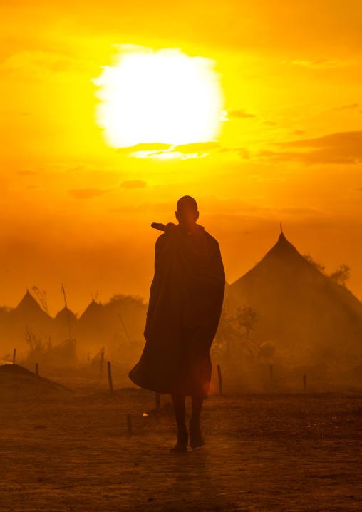 Mundari tribe man in the sunset, Central Equatoria, Terekeka, South Sudan