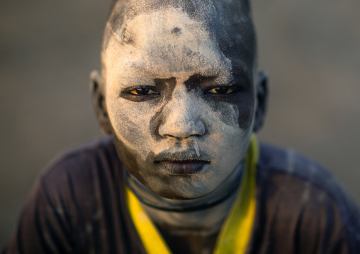 Mundari tribe boy covered in ash to protect from the mosquitoes and flies, Central Equatoria, Terekeka, South Sudan