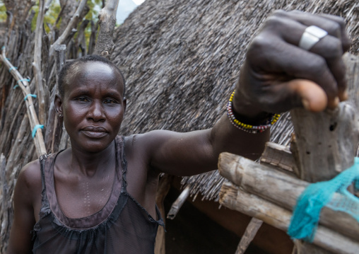 Woman in front of a Lotuko tribe thatched house, Central Equatoria, Illeu, South Sudan