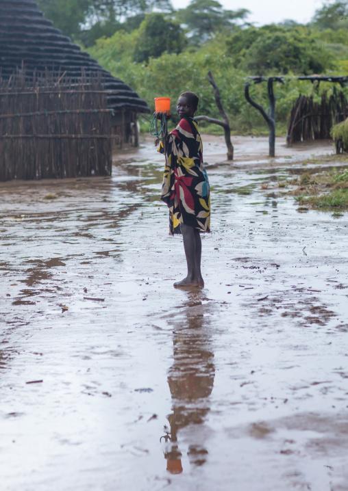 Larim tribe girl under the rain in a village, Boya Mountains, Imatong, South Sudan
