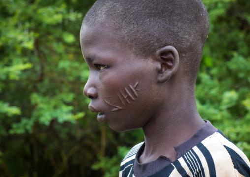 Larim tribe boy with scarifications on the cheek, Boya Mountains, Imatong, South Sudan